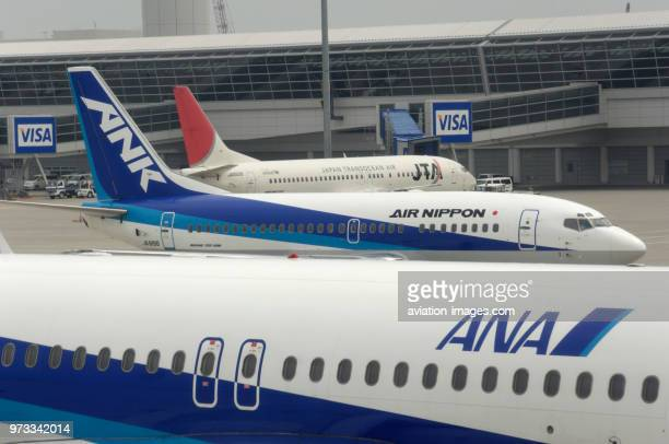 an ANA All Nippon Airways Airbus A320200 with an ANK Boeing 737 taxiing and a JTA B737 parked at the terminal behind