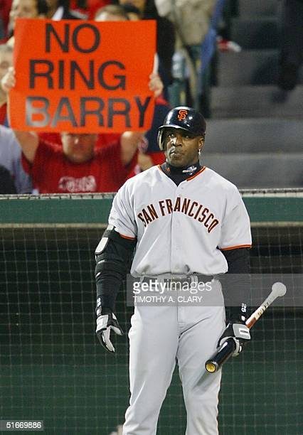An Anaheim Angels fan displays his hopes for Game Seven of the World Series over San Francisco Giants slugger Barry Bonds' shoulder at the start of...