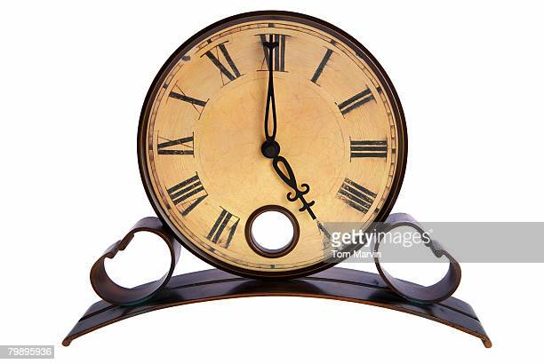 An analog clock shows 5 p.m., time to leave work.