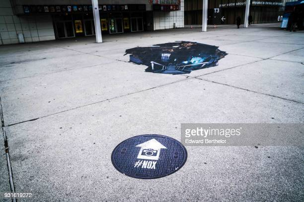 An anamorphosis is displayed on the street at Bibliotheque Francois Mitterand to Promote Canal TV Serie Nox on March 13 2018 in Paris France