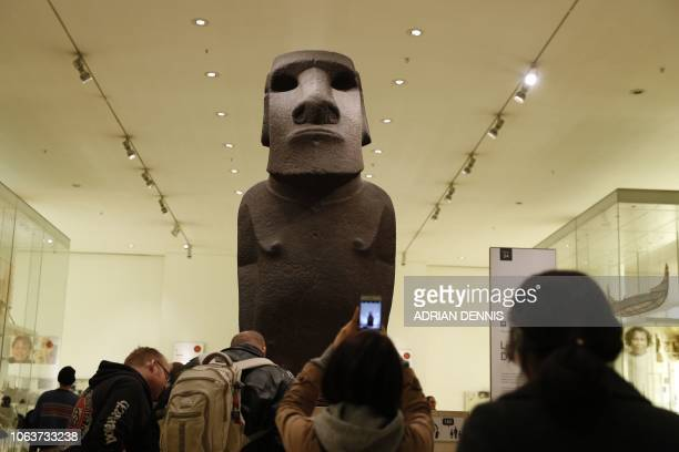 An ancestor figure 'moai' known as Hoa Hakananai'a stands at the entrance to the Wellcome gallery in the British Museum in London on November 20 2018