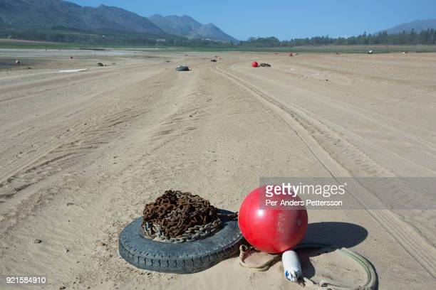 An anchor ball is exposed with an overview of a dry area in Theewaterkloof dam on February 8 2018 in Villiersdorp about 100 kilometers outside Cape...