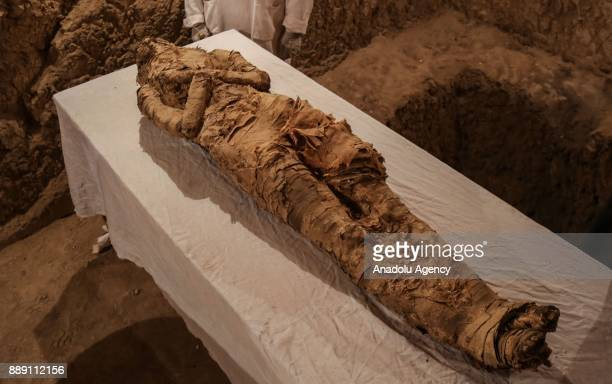 An ancient mummified body is seen that belongs to the 18th Dynasty pharaohs in Dra Abu elNaga district of Luxor Egypt on December 09 2017