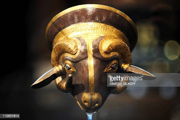 An ancient Thracian goldplated cup dating back from 3rd 4th century BC is displayed at the Thrace and the ancient world exhibition of a private...