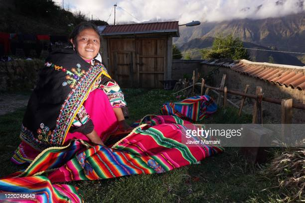 An andean woman poses with traditional clothing on June 12 2020 in Ayata Bolivia Andean women sew and embroider face masks with traditional Andean...