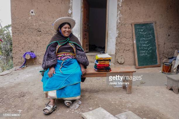 An andean woman prepares to embroider protective masks on June 12 2020 in Ayata Bolivia Andean women sew and embroider face masks with traditional...