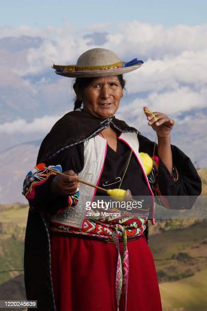 An andean woman winds a ball of yarn on June 12 2020 in Ayata Bolivia Andean women sew and embroider face masks with traditional Andean themes which...