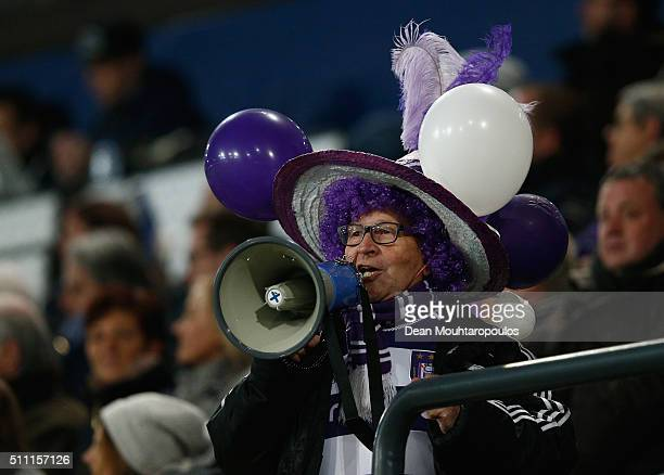 An Anderlecht fan show his support during the UEFA Europa League round of 32 first leg match between Anderlecht and Olympiakos FC at Constant Vanden...