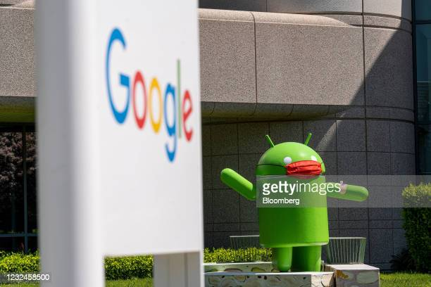 An Android statue wearing a mask on the Google campus in Mountain View, California, U.S., on Wednesday, April 21, 2021. Silicon Valley has the lowest...