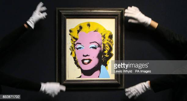 An Andy Warhol portrait of Marilyn Monroe titled Lemon Marilyn at Christie's in London before the Christie's PostWar and Contemporary Art sale taking...
