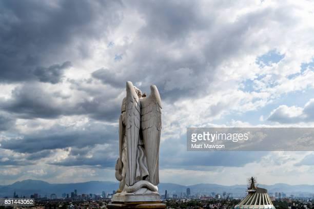 an angel on top of tepeyac hill looking over mexico city - festival de la virgen de guadalupe fotografías e imágenes de stock