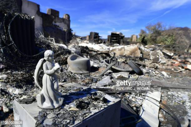An angel ornament appears to have withstood damage amid the destruction of a hilltop house with a view along Lobo Canyon Road in Agoura Hills...