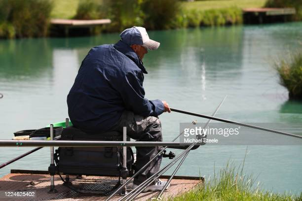 An angler at Acorn Fisheries on May 13 2020 in Kingston Seymour Somerset England The prime minister announced the general contours of a phased exit...