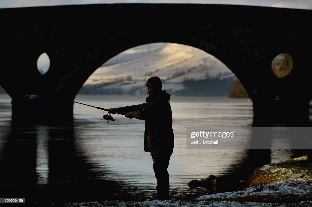 An angler casts during the opening of the salmon fishing season on the River Tay January 15, 2013 in Kenmore, Scotland. A procession with a pipe band and anglers made its way through Kenmore at the east end of Loch Tay to mark the start of the 2012 salmon season on the River Tay.