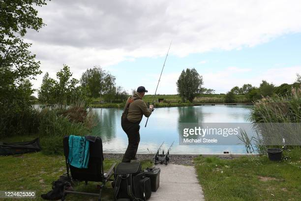 An angler casts off at Acorn Fisheries on May 13 2020 in Kingston Seymour Somerset England The prime minister announced the general contours of a...