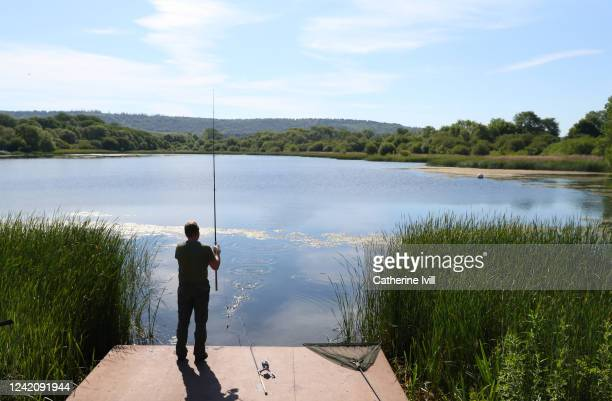 An angler fishes at a local reservoir on June 02, 2020 in Aylesbury, United Kingdom . The British government further relaxed Covid-19 quarantine...