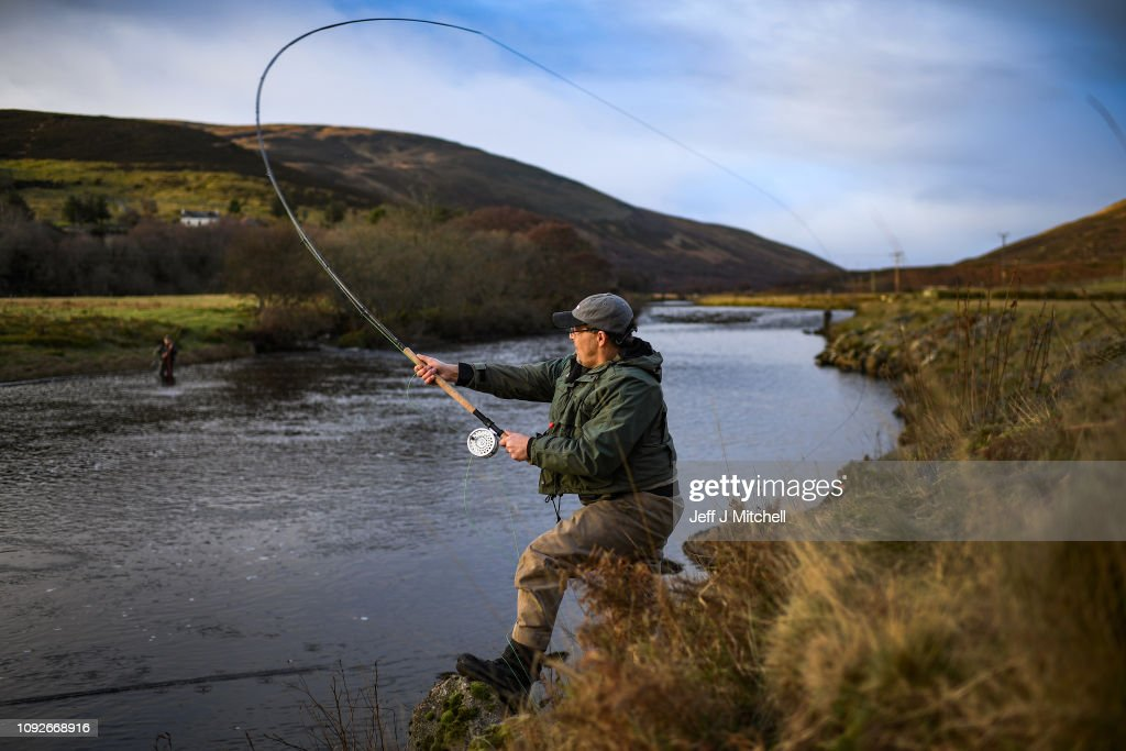 An angler fishes at the opening Of The Salmon Fishing Season : News Photo