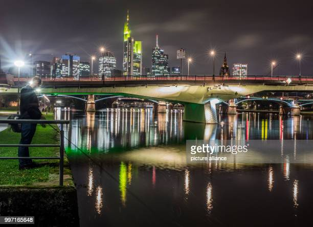 An angler fishes on the banks of the river Main in Frankfurt Germany 10 October 2017 Photo Frank Rumpenhorst/dpa