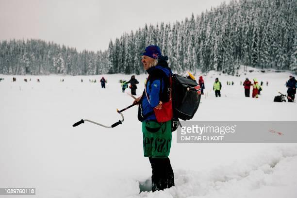 An angler from Norway team takes his position during the XVI World Ice Fishing Championship at the Shiroka Polyana dam near Batak on January 26 2019...