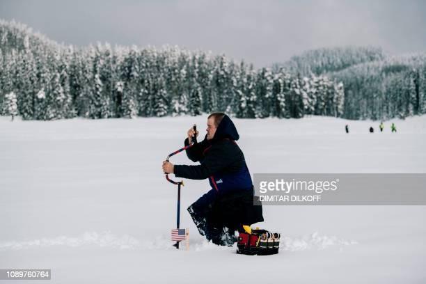 An angler from US team drills a hole in the ice during the XVI World Ice Fishing Championship in Shiroka Polyana dam near Batak on January 26 2019...