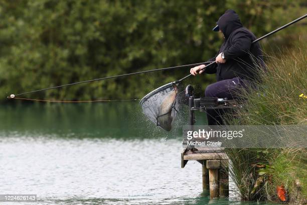 An angler nets a carp at Acorn Fisheries on May 13 2020 in Kingston Seymour Somerset England The prime minister announced the general contours of a...