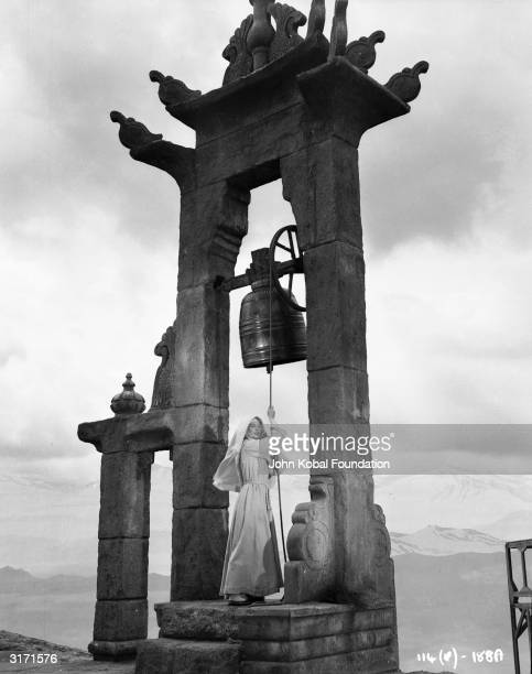 An Anglican nun played by Deborah Kerr tugs on the bellrope of a religious community in the Himalayas in a scene from 'Black Narcissus' directed by...