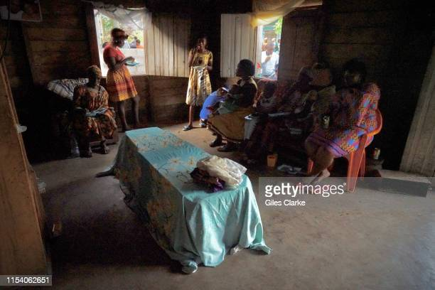 An Anglophone family gather for a relative's funeral in a the house of a village that is now abandoned but where the deceased wished to be buried on...