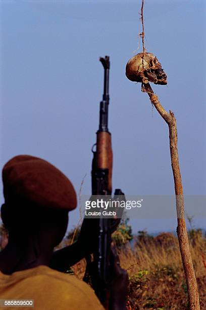 An Angolan government soldier stands guard at a roadblock that is marked with a human skull After Angola gained independence from Portugal in 1975...