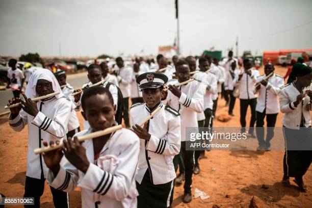 TOPSHOT An Angolan marching band from the 'Church of Jesus Christ on Earth by His special envoy Simon Kimbangu' march past during an electoral...