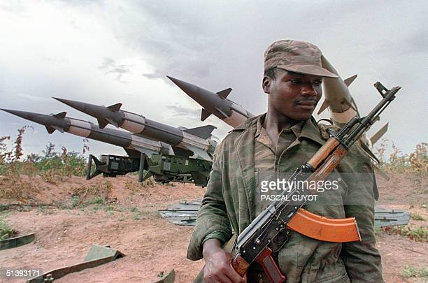 An Angolan soldier holding a Sovietmade AK47 Kalachnikov submachine guards a battery of Sovietmade groundtoair missiles 29 February 1988 near Cuito...