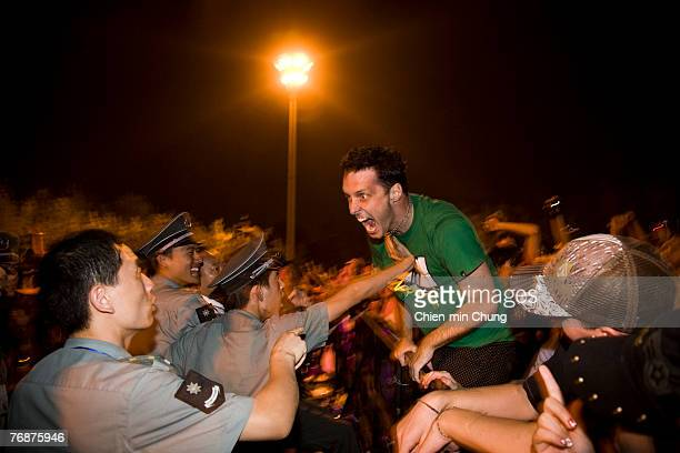 An angry fan confronts security guards at the Beijing Pop Festival September 8 2007 in Beijing China The Beiing 2007 Pop festival featured acts...