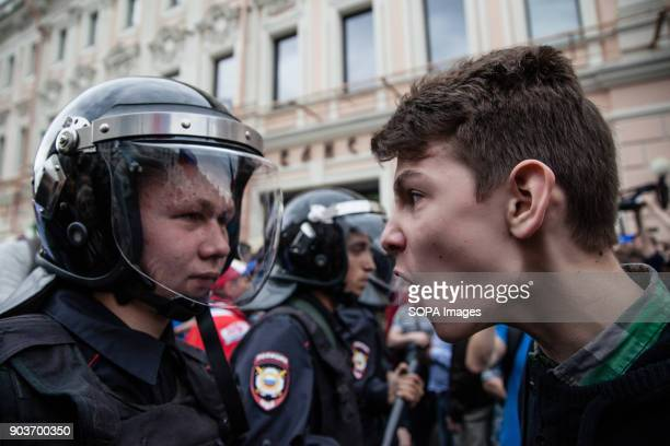 An angry protester seen shouting in front of a policeman Anticorruption protest organised by opposition leader Alexei Navalny at Tverskaya Street