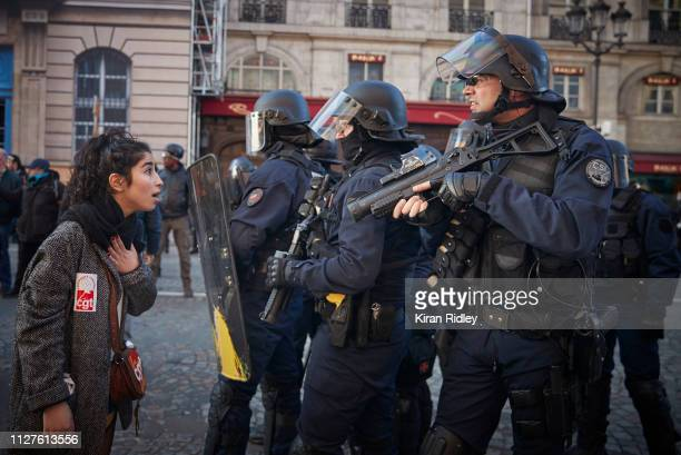 An angry protestor confronts French Riot Police after peaceful demonstrations, which were part of National General Strike along the Rue de Rivoli,...
