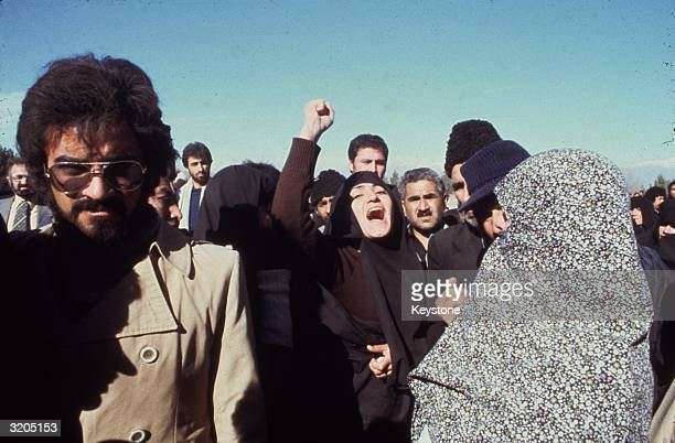 An angry protestor shaking her fist during demonstrations calling for the Shah of Iran to be replaced