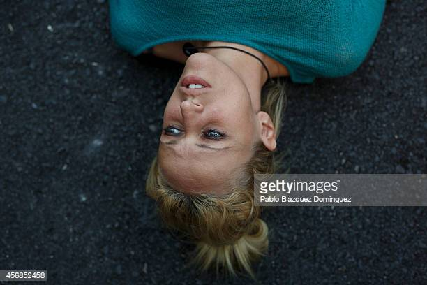 An animal rights protester lays on the ground after a veterinary van allegedly containing the dog named Excalibur drove away from an apartment...