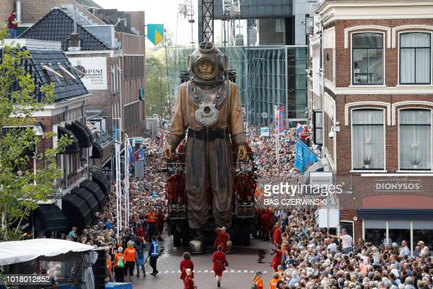 TOPSHOT An animated marionette a socalled Giant of French street theatre company Royal de Luxe parades through the streets in the European Capital of...