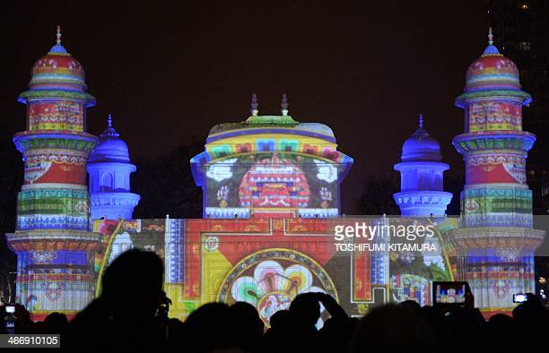 An animation is projected onto a large snow sculpture of Tomb of ItmadudDaula India during the 65th annual Sapporo Snow Festival in Sapporo on...
