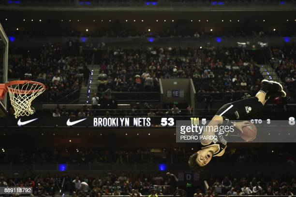 TOPSHOT An animator performs at halftime in the NBA Global Games match Miami Heat against Brooklyn Nets at Mexico City's Arena on December 9 in...