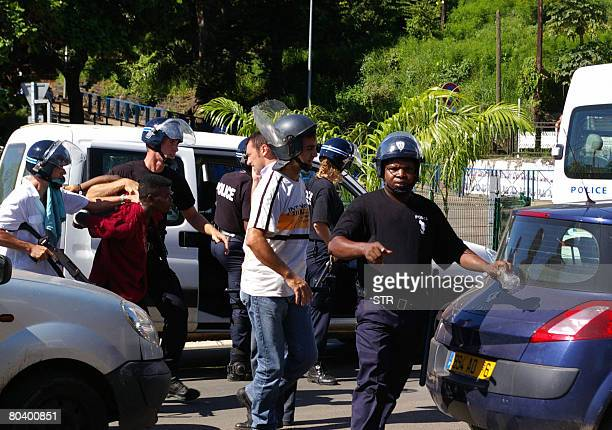 An Anjouan demonstrator is takne by police on March 27 2008 during a protest against presence of renegade Comoran leader Mohamed Bacar in Mamoudzou...