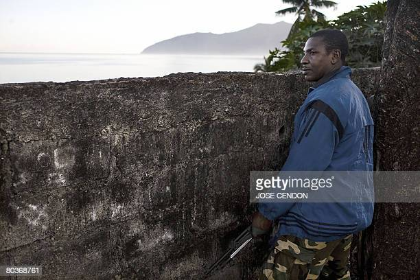 An Anjouanese gendarme waits to fight the Comoran and African Union troops in Mutsamudu on March 25 2008 African Union and Comoran troops are still...