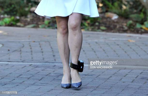 An ankle monitor is seen on Huawei Chief Financial Officer, Meng Wanzhou as she leaves her Vancouver home to appear in British Columbia Supreme Court...