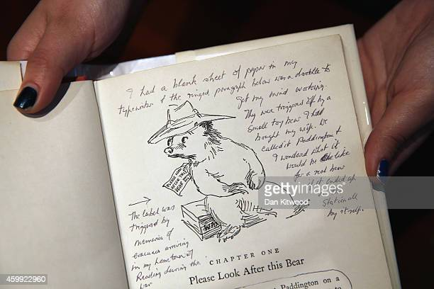 An annotated page from 'A Bear Called Paddington' by Peggy Fortnum is displayed at Sotheby's auction House on December 4 2014 in London England A...