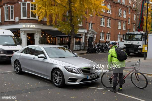 An annoyed cyclist stops to confront a motorist and very slowly check his bike over for any damage after a Mercedes driver nudged his rear wheel in...