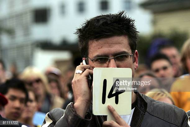 An anonymous buyer during the auction of the first two units of the second series of the reality television show 'The Block' July 24 2004 in Manly...