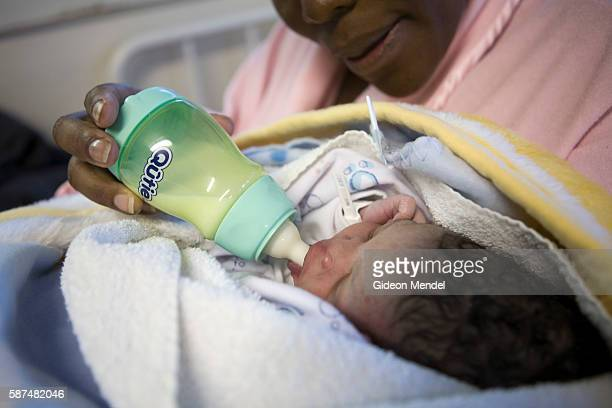 An anonymous mother bottle feeds her new born baby girl in Queen Elizabeth Hospital Maseru The mother who is HIV positive has been enrolled on a...