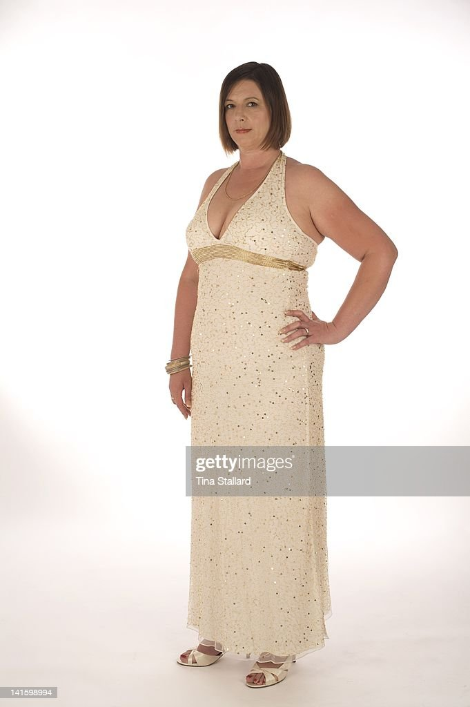 An anonymous woman , 44, nearly 2 years after she had a gastric band fitted to help her lose weight. She originally weighed nearly 20 stone (126kg) and was severely obese. Since then she she has lost three stone (19kg) but is still obese. She needs to lose a further 4 stone (25kg) to be a healthy weight.