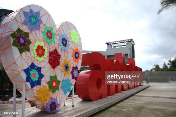 An Antalya sign with a big white heart decorated with woolen products is seen during the Woolen Tales exhibition at Migros Shopping Mall in Antalya...