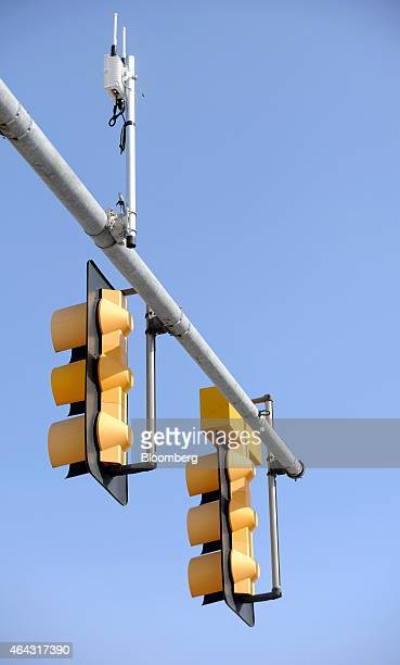 An antenna capable of communicating information to properly fitted vehicles sits atop a traffic signal just outside the University Of Michigan...