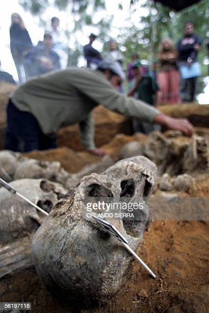 An anthropologist works on a mass grave found in what used to be the rural military outpost Palabor in Comalapa department of Chimaltenango 80 km...