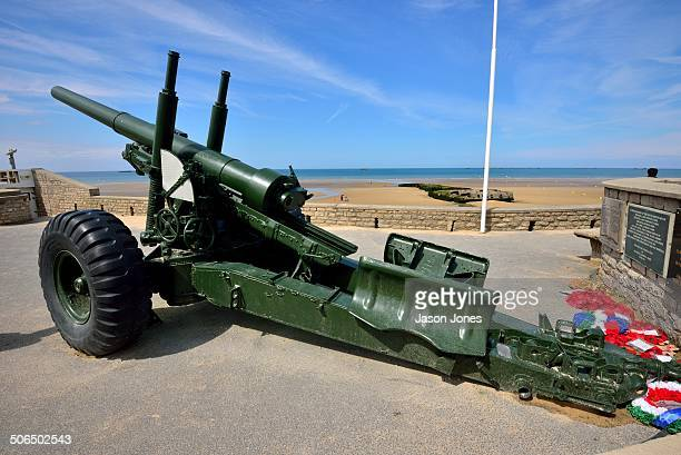 An Anti aircraft gun from WWII on the seafront at Arromanches Les Bains